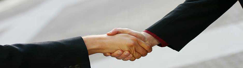 2 people shaking hands photo